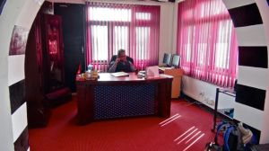 Binod Paudel, CEO. In his clapboard inspired office at Oscar College